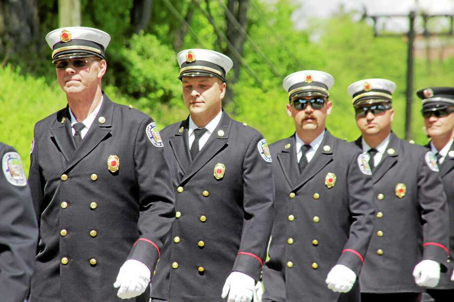 Members of the Bantam Fire Company march in the Bantam Memorial Day Parade Sunday. Photo: Shako Liu ­— The Register Citizen