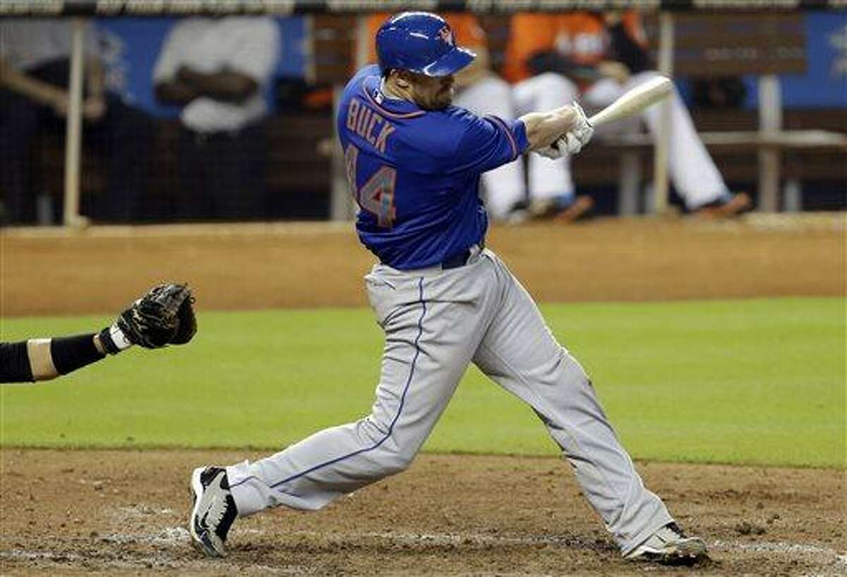 New York Mets' John Buck hits an RBI double to score two runs in the seventh inning of a baseball game against the Miami Marlins, Wednesday, May 1, 2013, in Miami. The Mets won 7-6.(AP Photo/Lynne Sladky)
