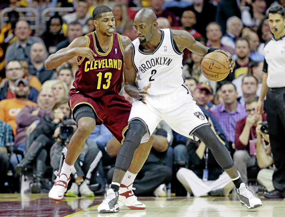 The Nets' Kevin Garnett (2) tries to get past the Cavaliers' Tristan Thompson during the fourth quarter of Wednesday's game in Cleveland. The Cavs beat Brooklyn 98-94.