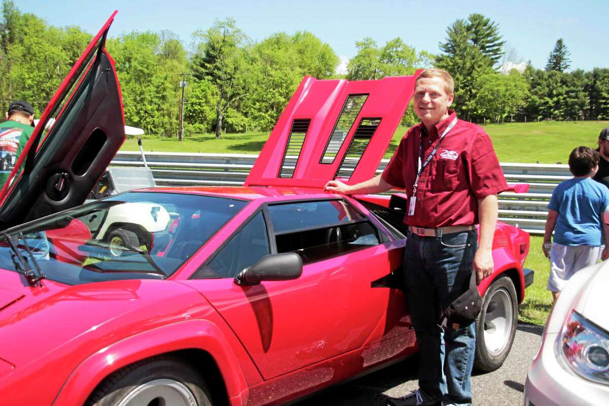 Neil Volkmar and his Lamborghini (Shako Liu-The Register Citizen)