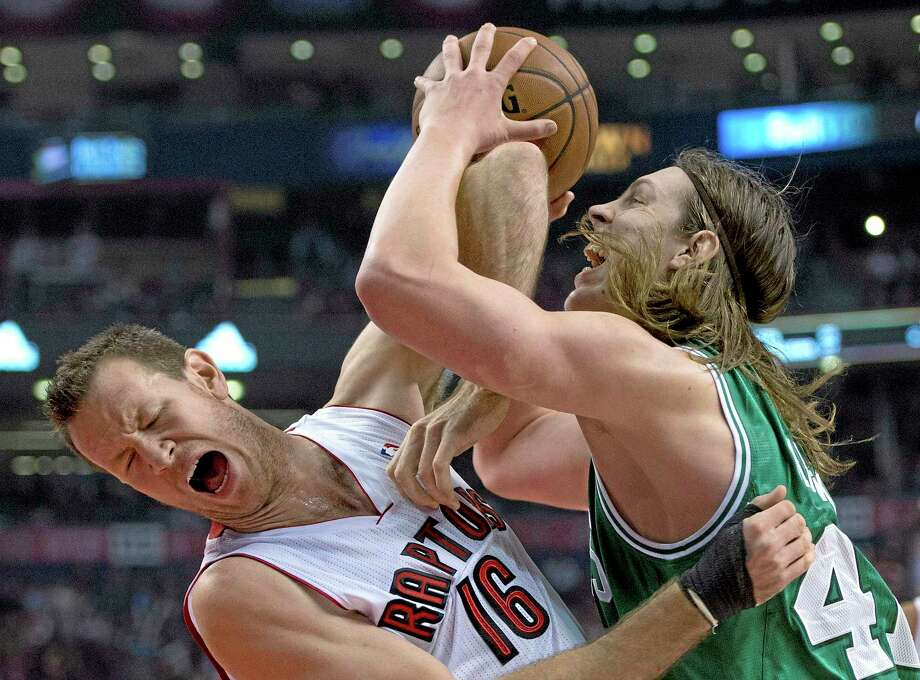 Celtics forward Kelly Olynyk, right, fouls Toronto Raptors forward Steve Novak on his way to the basket during the first half of Wednesday's game in Toronto. Photo: Frank Gunn — The Canadian Press  / The Canadian Press