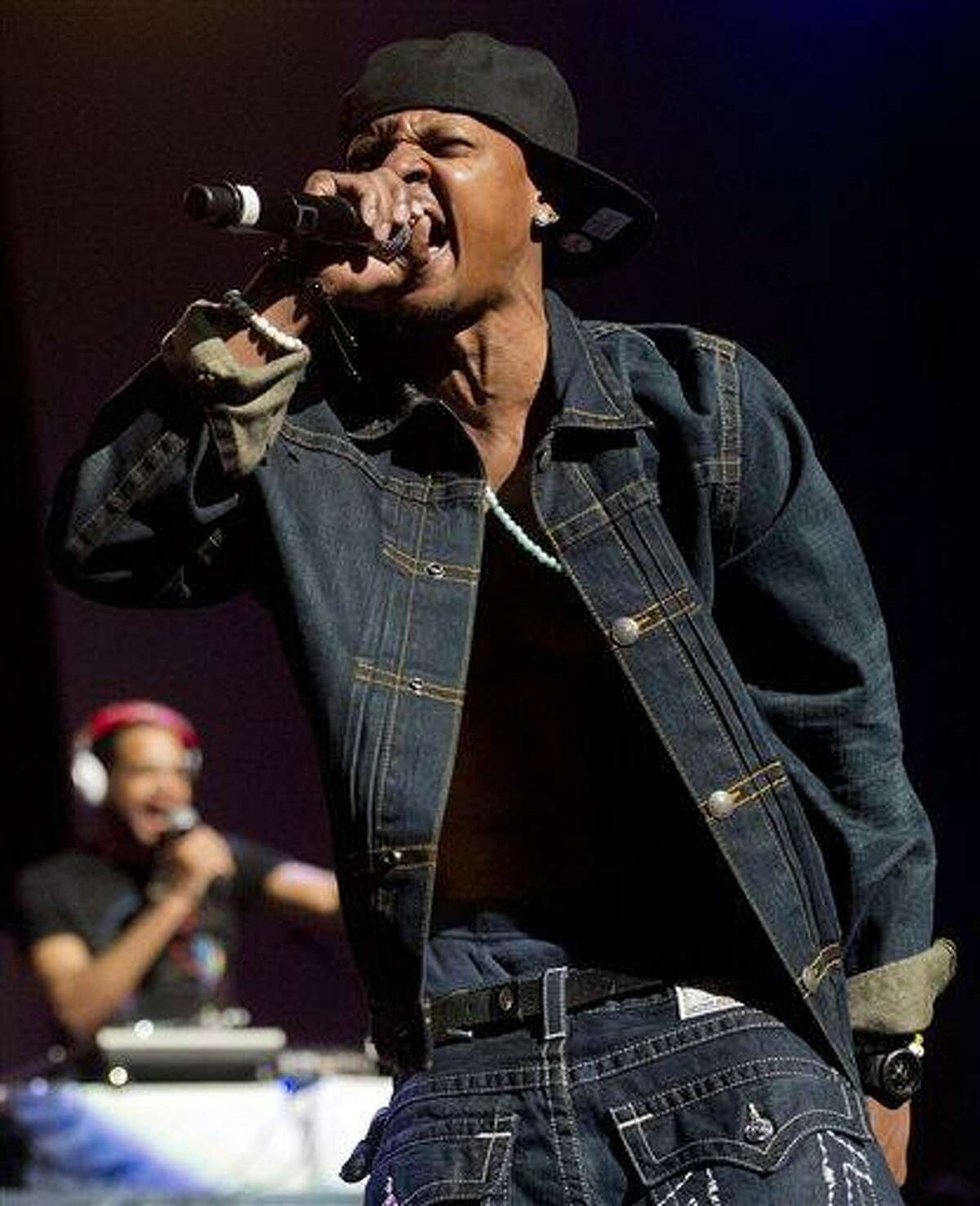 In this Feb. 23, 2013 photo, Chris Kelly of Kris Kross performs on stage at the Fox Theatre in Atlanta during the So So Def 20th Anniversary Concert. Kelly, half of the 1990s kid rap duo Kris Kross who made one of the decade's most memorable songs with the frenetic