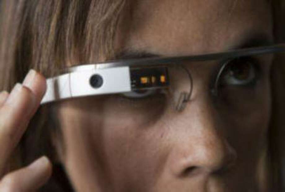 Software Developer Monica Wilkinson wears Google Glass at Crushpath in San Francisco, Friday, April 27, 2013.Google isn't selling them yet but it's allowed some software developers to buy an early version so they can try it out and create new apps for the device. Photo: Bay Area News Group / Bay Area News Group