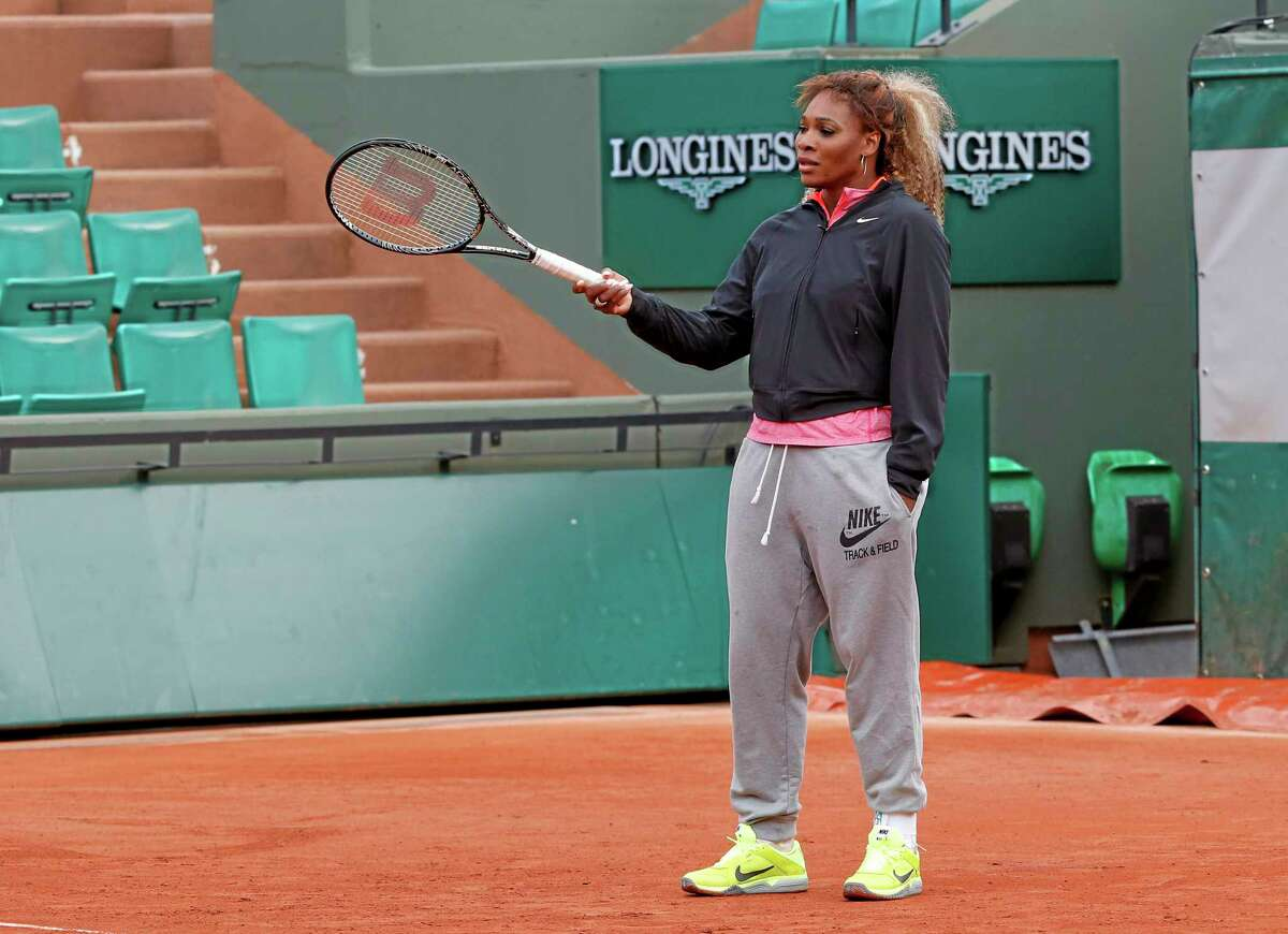 Serena Williams of the U.S., gestures with her racket during a training session for the French Open tennis tournament, at the Roland Garros stadium in Paris, Saturday, May 24, 2014. The French Open tennis tournament starts Sunday. (AP Photo/Michel Euler)