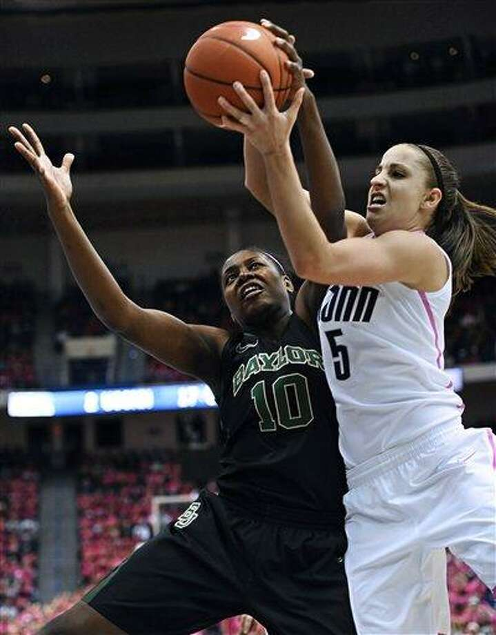 Baylor's Destiny Williams, left, and Connecticut's Caroline Doty, right, fight for control of the ball during the first half of an NCAA college basketball game in Hartford, Conn., Monday, Feb. 18, 2013. (AP Photo/Jessica Hill) Photo: ASSOCIATED PRESS / A2013