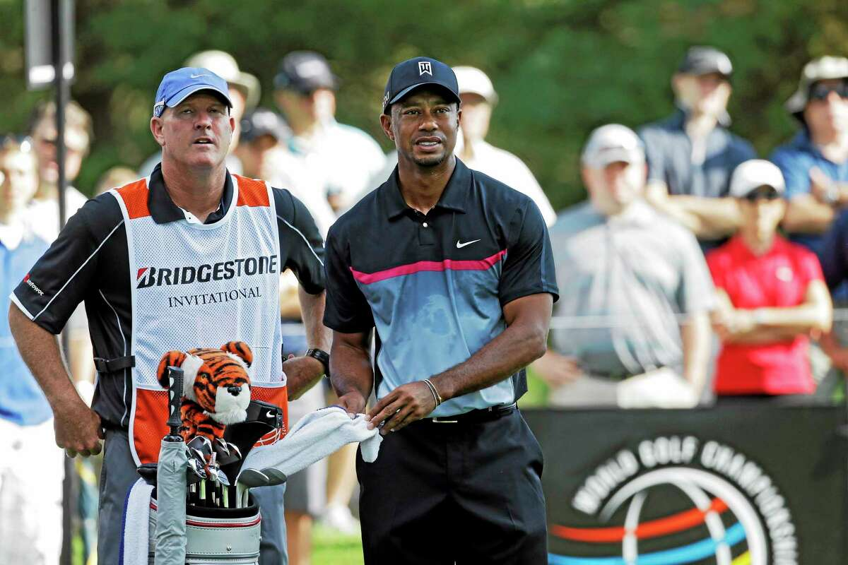 Tiger Woods and caddie Joe LaCava, left, look from the 12th tee during the first round of the WGC Bridgestone Invitational last August.