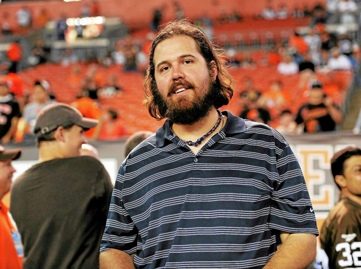 The Cleveland Indians have released closer Chris Perez, here watching the Buffalo Bills and Cleveland Browns warm up before their Oct. 3 game in Cleveland.