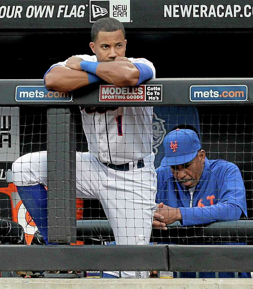 The Mets' Chris Young watches from the dugout railing during the ninth inning of Saturday's 3-2 loss to the Arizona Diamondbacks in New York. Photo: Julie Jacobson — The Associated Press  / AP