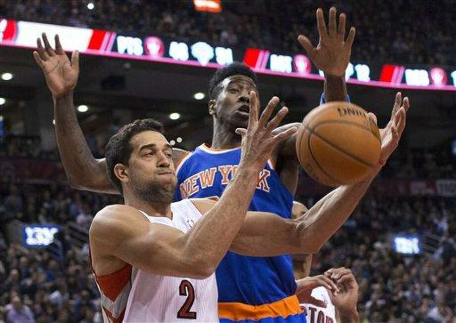 Toronto Raptors' Landry Fields, left, and New York Knicks' Iman Shumpert try to get control of the ball during the first half of an NBA basketball game in Toronto on Friday, Feb. 22, 2013. (AP Photo/The Canadian Press, Chris Young) Photo: ASSOCIATED PRESS / AP2013