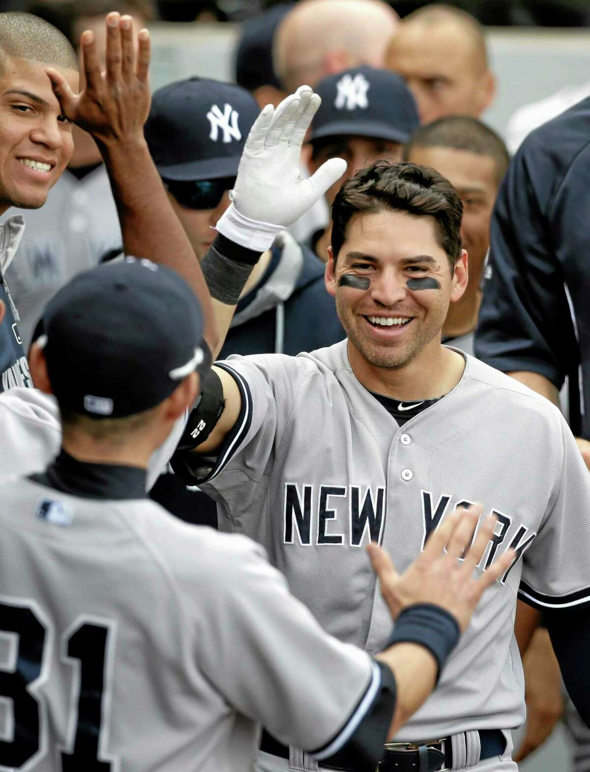 The Yankees' Jacoby Ellsbury celebrates with teammates after hitting a home run during the 10th inning Saturday.