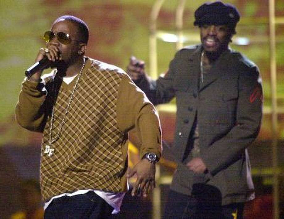 Big Boi, left, and Andre 3000, right, better known as the duo Outkast go through rehearsal for the Grammy Awards, Sunday, Feb. 24, 2002, at the Staples Center in Los Angeles. Outkast will perform during the awards show Wednesday, Feb 27, 2002. Photo: AP / AP