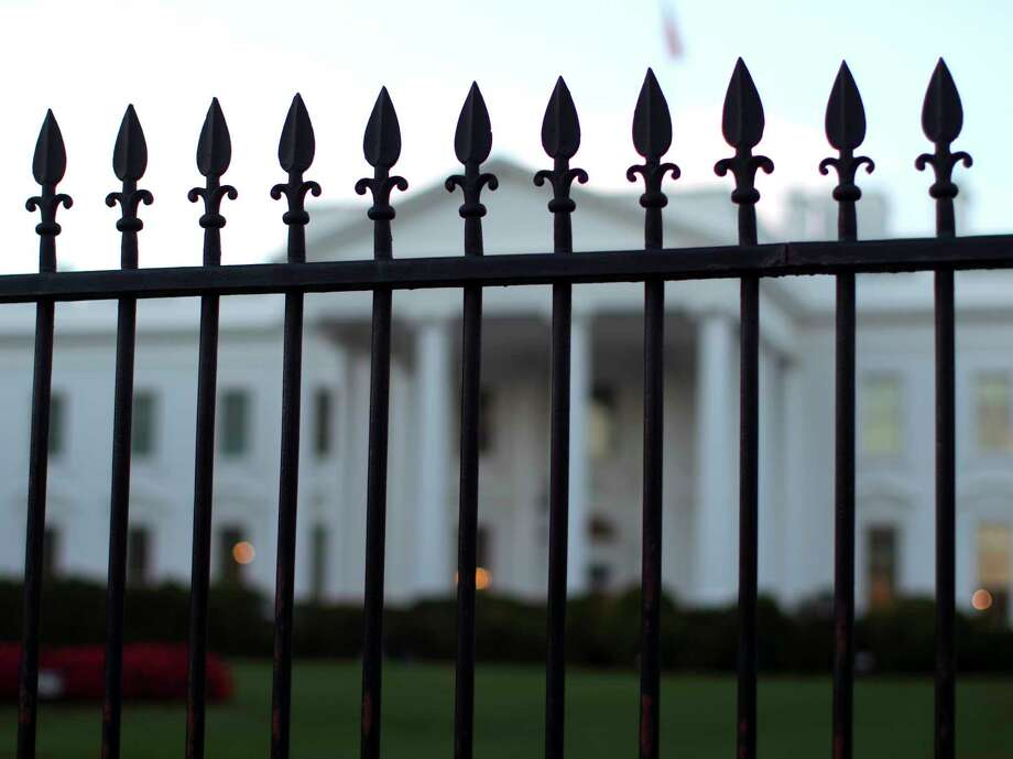 The White House is seen through the North Lawn perimeter fence in Washington, Tuesday, Sept. 23, 2014. An intruder managed to jump the north fence of the White House and escape capture until he was inside the North Portico entrance of the White House. Photo: (AP Photo/Carolyn Kaster) / AP