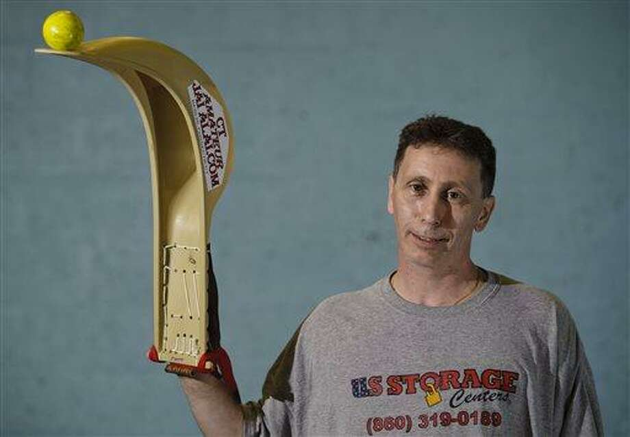 In this June 20, 2013 photo, Matt DiDomizio poses at the Connecticut Amateur Jai Alai, which he runs in Berlin, Conn. With two courts, people can either learn the sport with classes or take part in competitions. (AP Photo/Republican-American, Erin Covey) Photo: AP / Republican-American