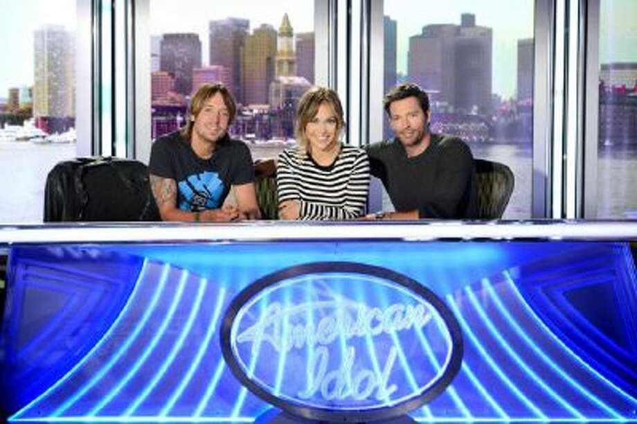"""This 2013 publicity photo released by FOX shows American Idol XIII judges, from left, Keith Urban, Jennifer Lopez and Harry Connick Jr. One thing about season 13 of """"American Idol"""" is that unlike last season, the judges seem to be getting along."""