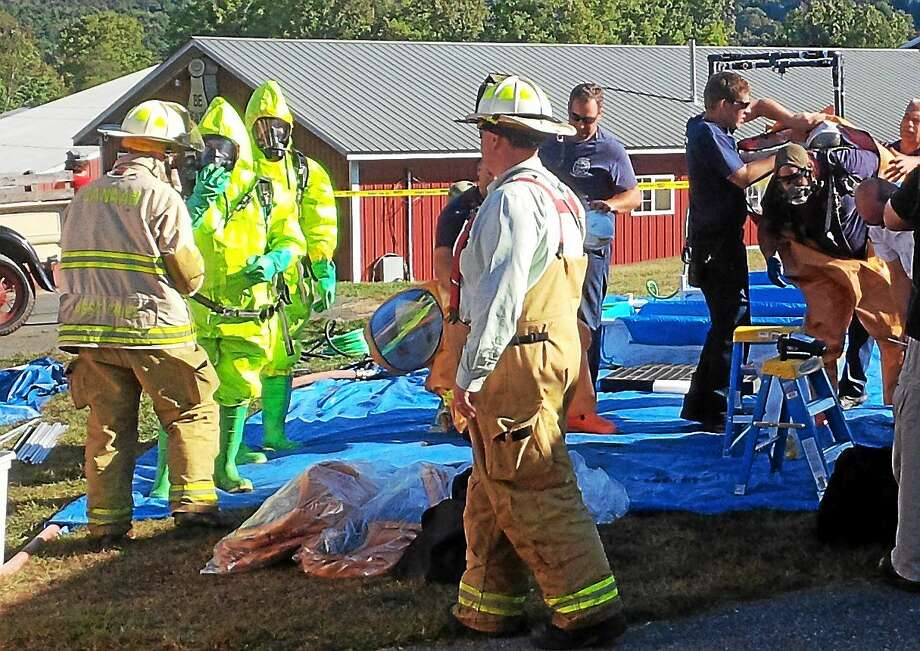 Contributed photo - Jonathan Barbagallo  Crews respond to a chemical spill at Elm Knoll Farm, located at 294 East Canaan Road, in North Canaan Tuesday. The state Department of Energy and Environmental Protection was on scene to handle cleanup, as well as several area fire departments. Photo: Journal Register Co.