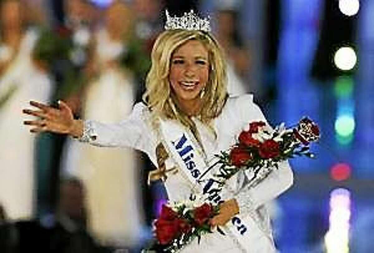In this Sept. 14, 2014, file photo, Kira Kazantsev walks the runway after she was named Miss America 2015 in Atlantic City, N.J.