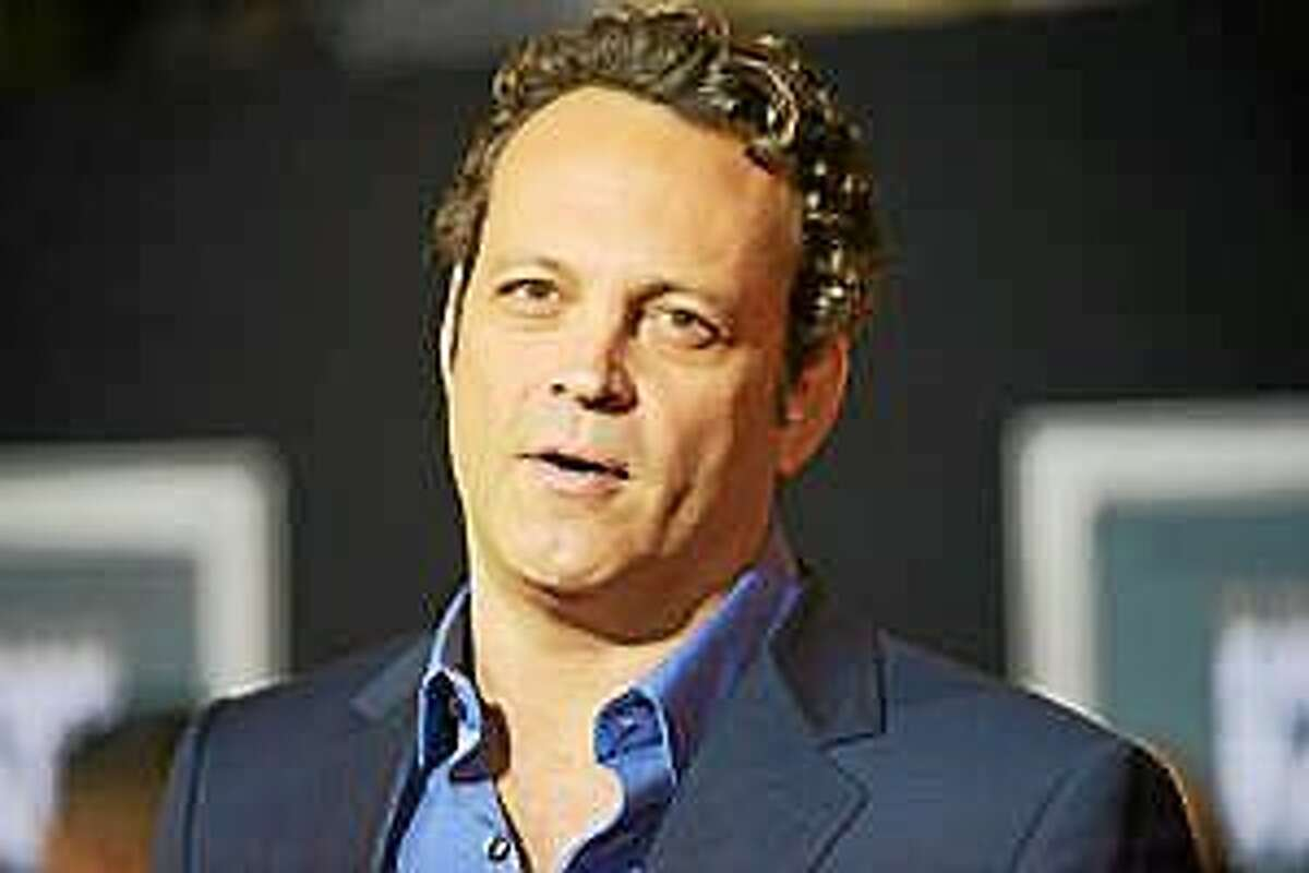 """FILE - In this Nov. 3, 2013 file photo, Vince Vaughn arrives at the world premiere of """"Delivery Man"""" at The El Capitan Theatre in Los Angeles. HBO says that Colin Farrell and Vaughn will star in the second season of """"True Detective."""" The eight-episode drama series will begin production in California this fall, the premium cable channel said Tuesday, Sept. 23, 2014."""