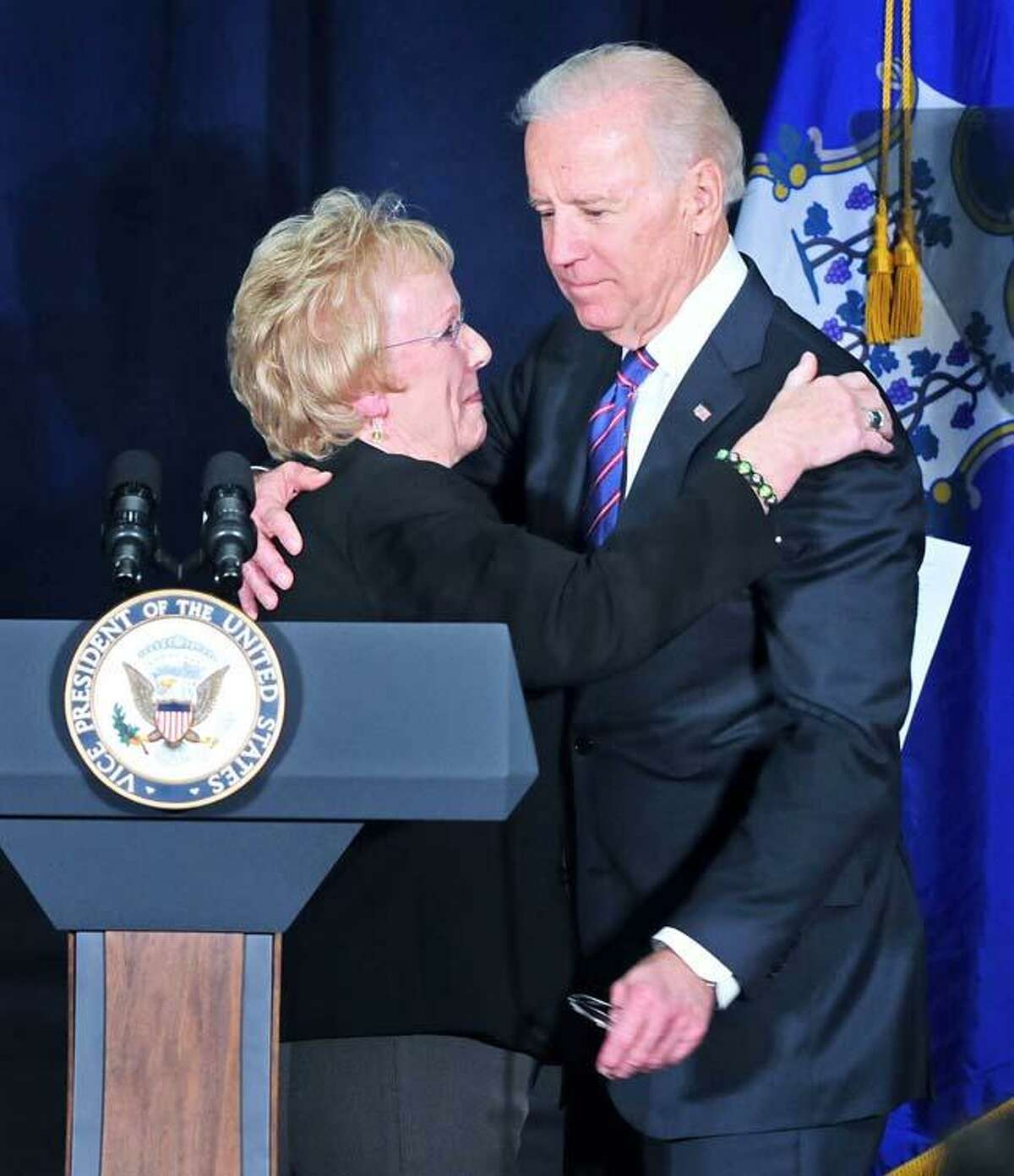 Newtown First Selectman E. Patricia Llodra (left) embraces Vice President Joe Biden (right) before he speaks at a Conference on Gun Violence at the Campus Center Ballroom at Western Connecticut State University in Danbury on 2/21/2013.Photo by Arnold Gold/New Haven Register