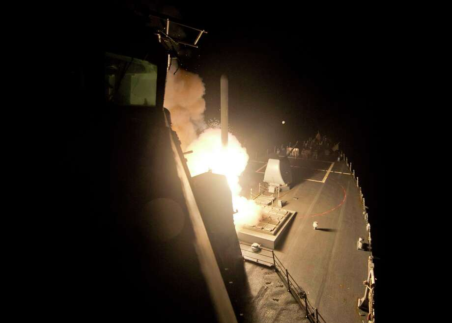 In this image provided by the U.S. Navy, the guided-missile destroyer USS Arleigh Burke (DDG 51) launches Tomahawk cruise missiles on Tuesday, Sept. 23 ,2014, from the Red Sea against Islamic State group targets in Syria. Photo: (AP Photo/U.S. Navy, Mass Communication Specialist 2nd Class Carlos M. Vazquez II) / U.S. Navy