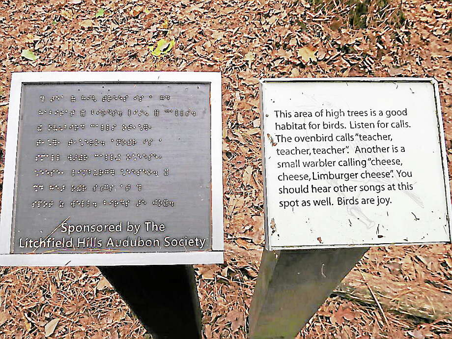 Plaques like this one, donated by the Litchfield Hills Audubon Society, adorn the Braille Trail, which will open Sunday at the White Memorial Conservation Center in Litchfield. Photo: Contributed Photo