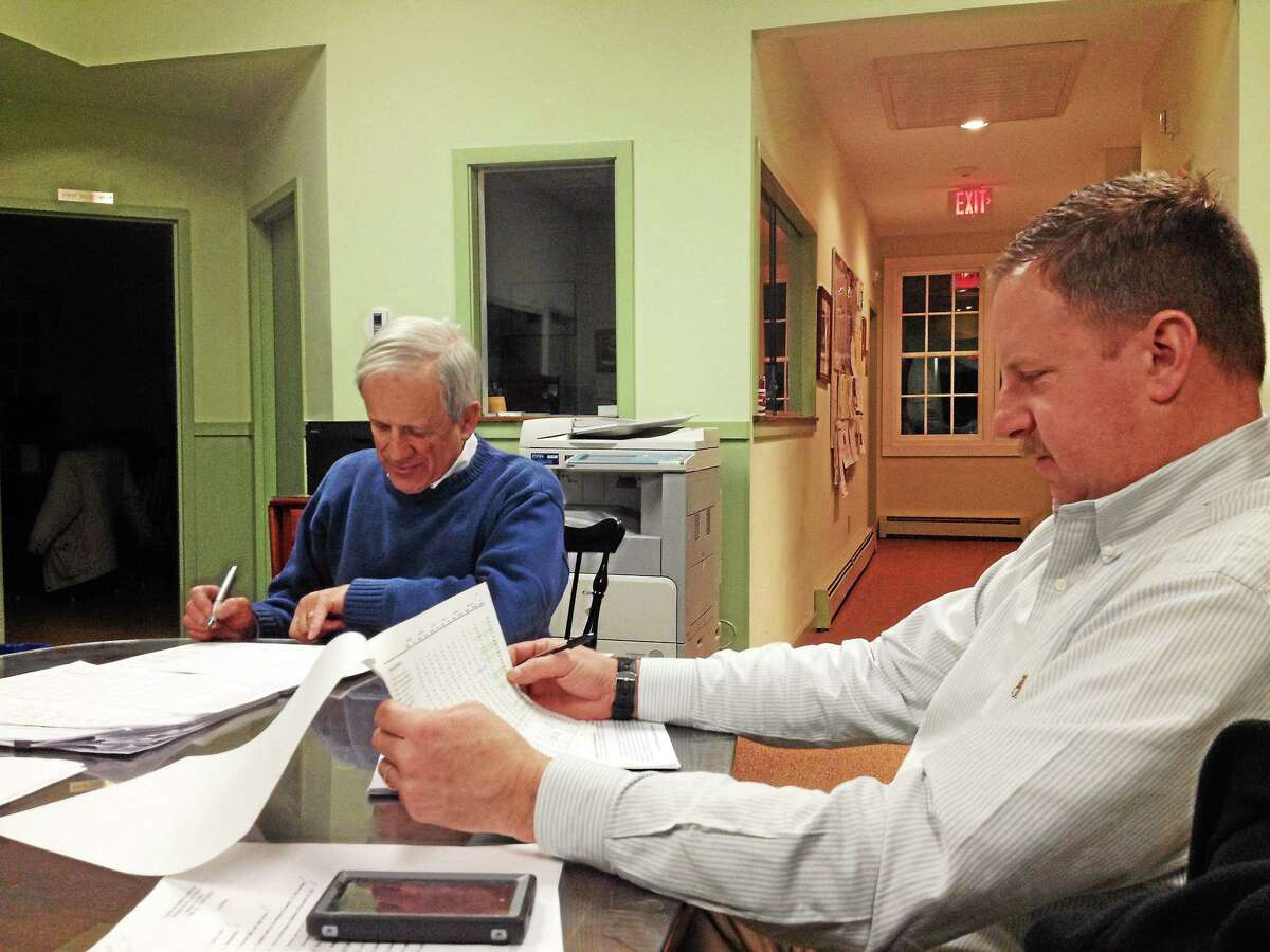 First Selectman Don Stein and Selectman Mark Hemenway discuss Barkhamsted's 2014-15 budget at the Board of Selectmen's Jan. 28, 2014 meeting.