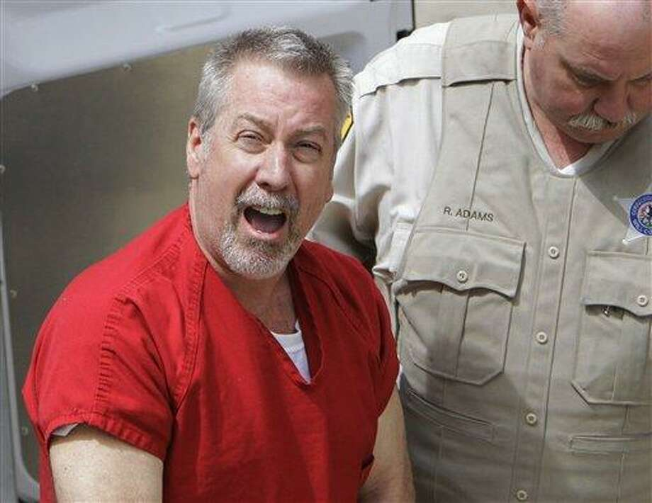 FILE - In this May 8, 2009 file photo, former Bolingbrook, Ill., police sergeant Drew Peterson arrives at the Will County Courthouse in Joliet, Ill., for his arraignment on charges of first-degree murder in the 2004 death of his third wife Kathleen Savio. On Thursday, Feb. 21, 2013, Will County Judge Edward Burmila sentenced Peterson to 38 years in prison for Savio's murder.  (AP Photo/M. Spencer Green, File) Photo: AP / AP