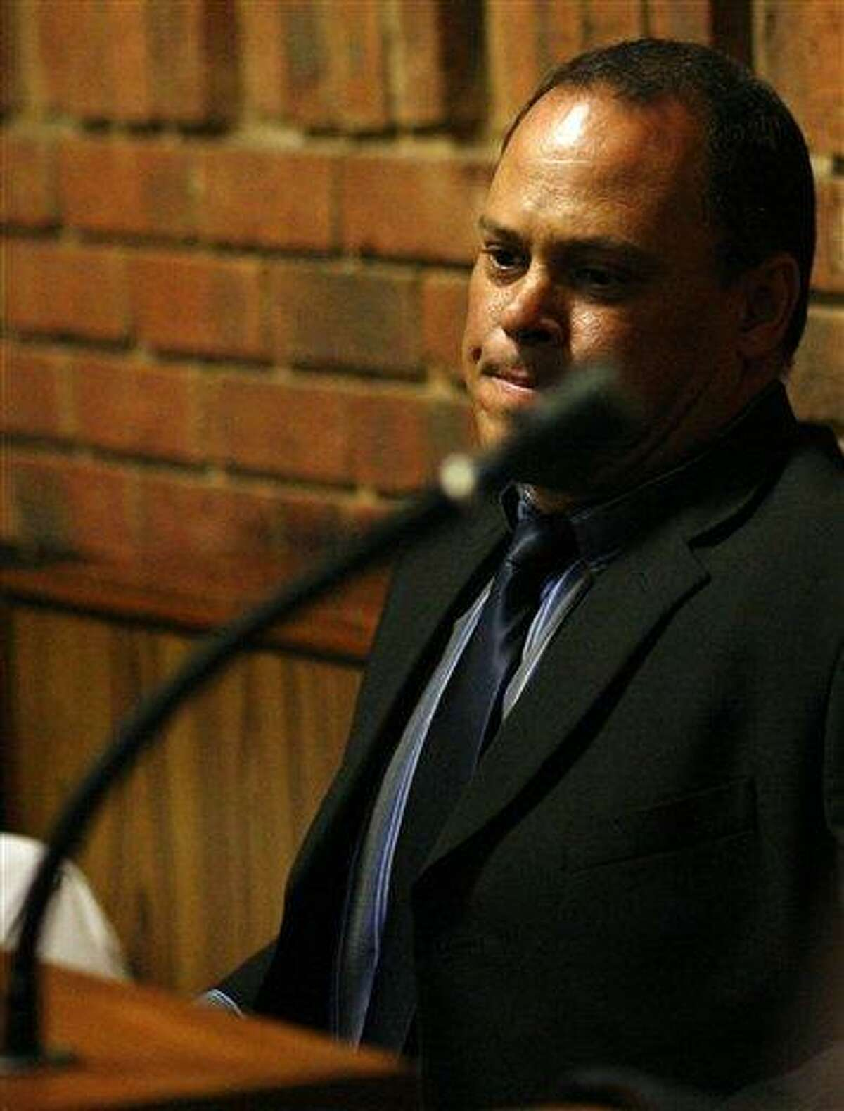 Investigating officer Hilton Botha sits inside the witness box during the bail hearing for Oscar Pistorius at the magistrate court in Pretoria, South Africa, Thursday, Feb. 21, 2013. South Africa's National Prosecuting Authority acknowledged that the timing of attempted murder charges against a police detective leading the investigation into Oscar Pistorius is