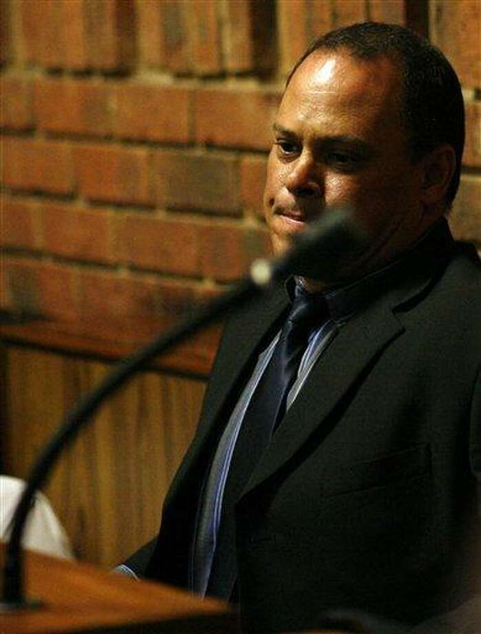 """Investigating officer Hilton Botha sits inside the witness box during the bail hearing for Oscar Pistorius at the magistrate court in Pretoria, South Africa, Thursday, Feb. 21, 2013. South Africa's National Prosecuting Authority acknowledged that the timing of attempted murder charges against a police detective leading the investigation into Oscar Pistorius is """"totally weird"""" and that he should dropped from the case against the world-famous athlete. (AP Photo/Themba Hadebe) Photo: ASSOCIATED PRESS / AP2013"""