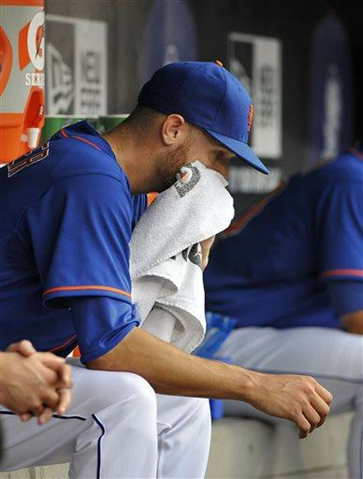 New York Mets starting pitcher Zack Wheeler sits in the dugout after being taken out of the baseball game against the Washington Nationals in the fifth inning at Citi Field on Sunday, June 30, 2013 in New York. (AP Photo/Kathy Kmonicek)