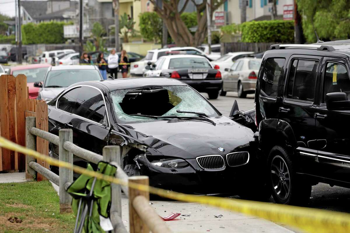 A black BMW sedan driven by a drive-by shooter is seen on Saturday, May 24, 2014, in Isla Vista, Calif. The shooter went on a rampage near a Santa Barbara university campus that left seven people dead, including the attacker, and seven others wounded, authorities said Saturday.