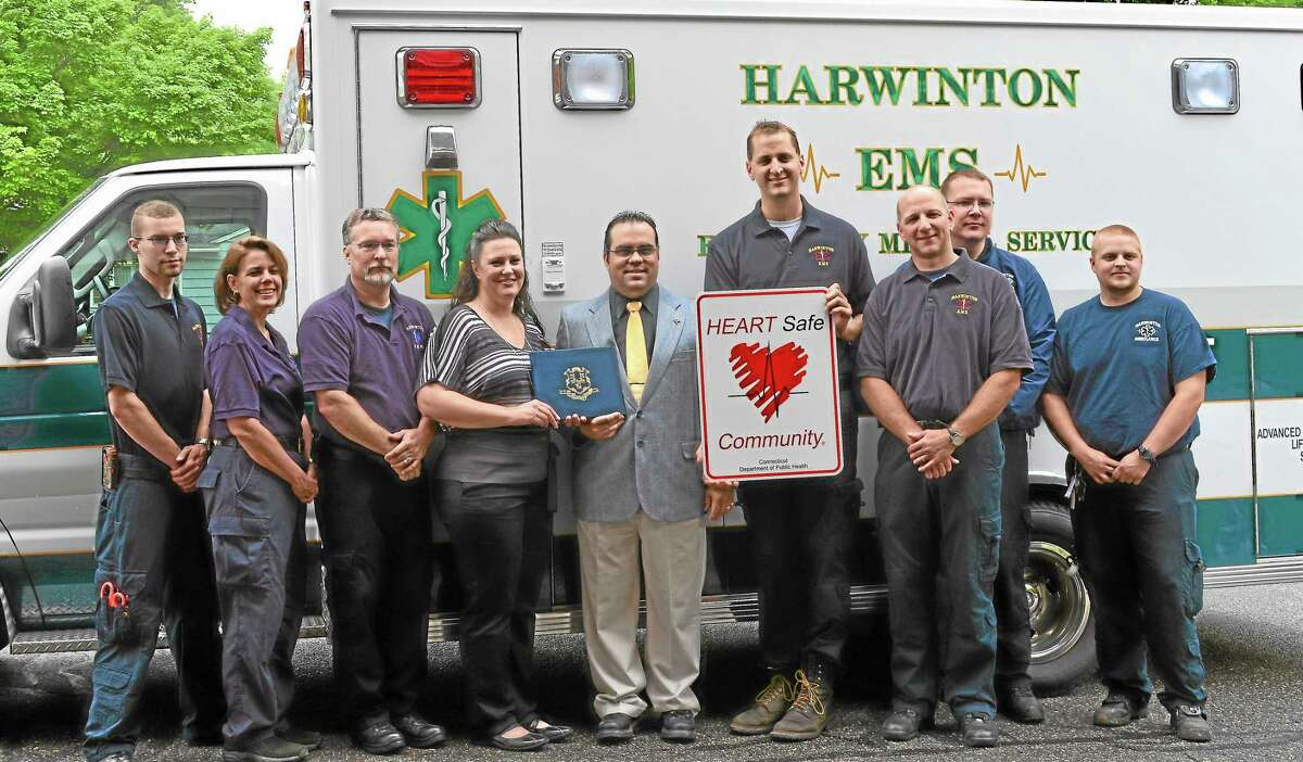 Members of Harwinton Ambulance/EMS receiving the HEARTSafe designation for Harwinton on their 50th anniversary along with First Selectman Michael Criss.