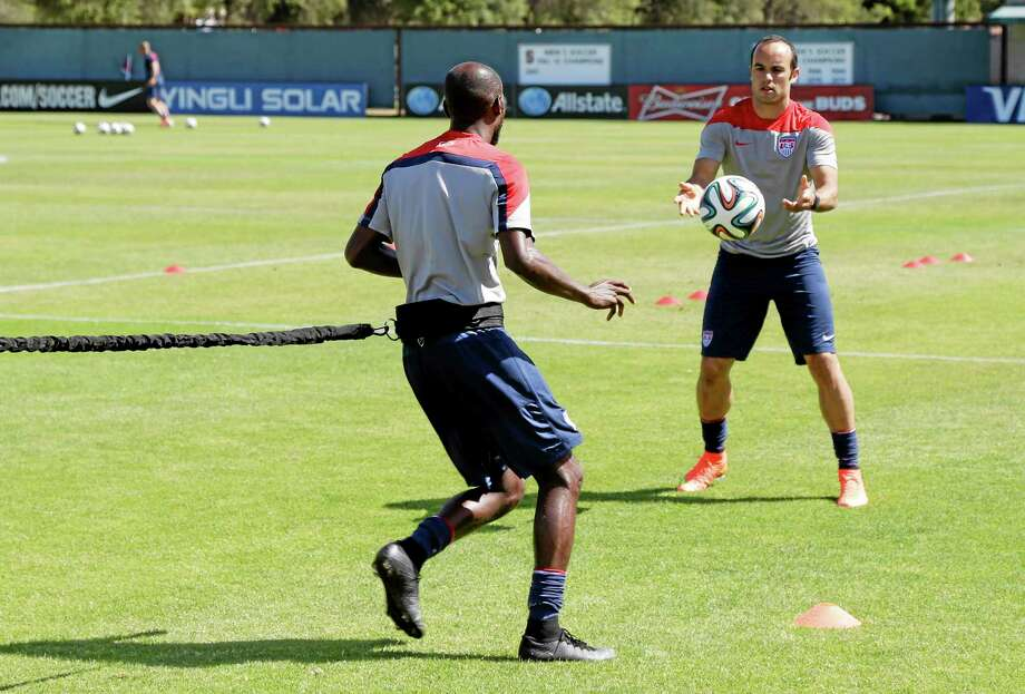 Landon Donovan, right, and DaMarcus Beasley take part in drills during training on Wednesday in Stanford, California. Photo: Marcio Jose Sanchez — The Associated Press  / AP