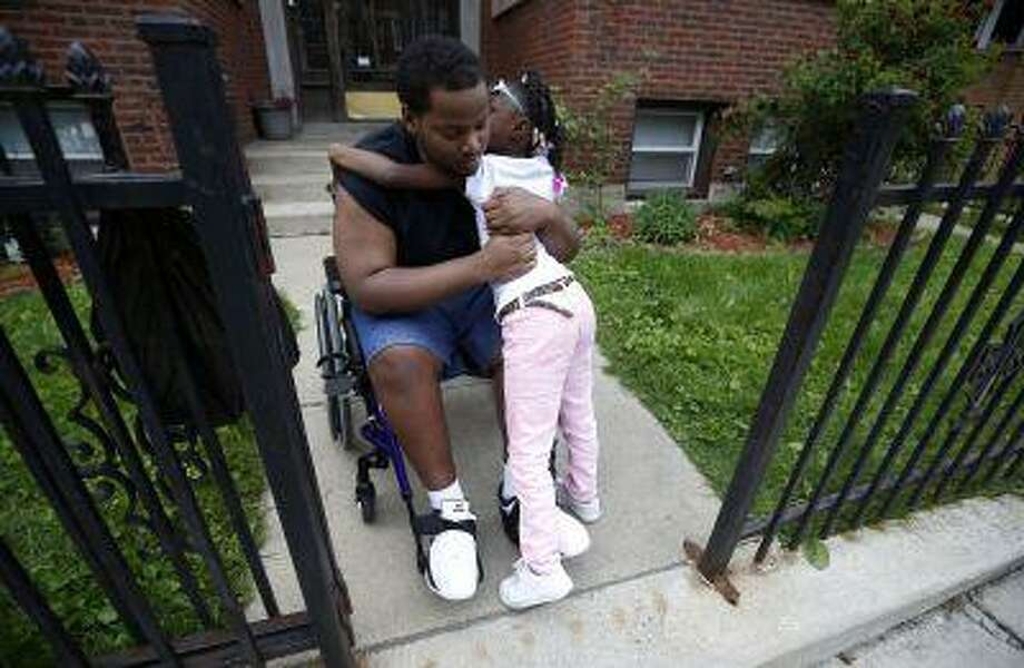 Miles Turner gets a hug from his cousin Sophia White at his home in Chicago, Illinois, June 9, 2013. Photo: REUTERS / X90065