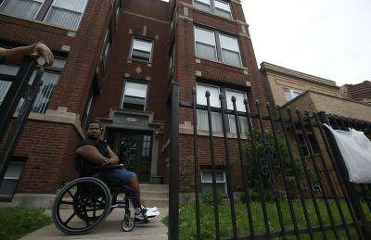 Miles Turner sits in front of his home in Chicago, Illinois, June 9, 2013. Turner, who was shot at least five times on a Chicago sidewalk last October, represents a largely untold side of the gun violence story. It's about the survivors who must live with costly and often permanently debilitating injuries.