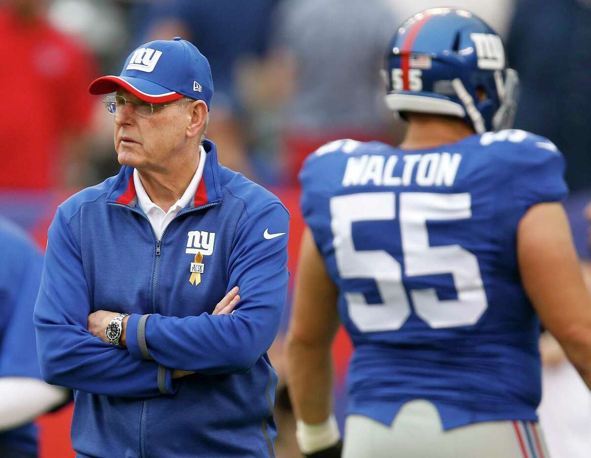 Giants head coach Tom Coughlin watches warmups before Sunday's game against the Houston Texans.