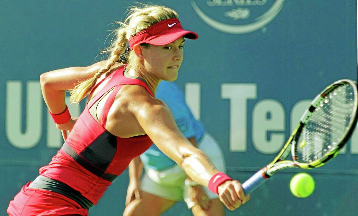 Genie Bouchard returns a shot during first-round action at the Connecticut Open last month.