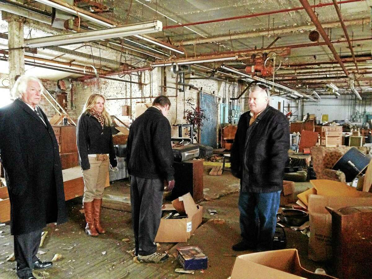 Town officials tour the abandoned Lambert Kay building in Winsted as they discuss possible remediation or destruction of the building.