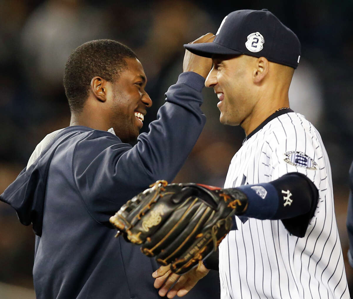 Yankees designated hitter Jose Pirela, left, celebrates with Derek Jeter (2) after the Yankees shut out the Orioles on Monday.