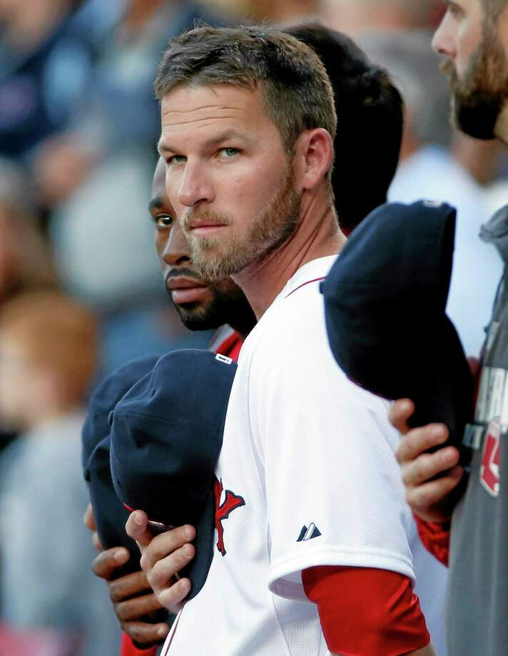 Newly re-signed Red Sox shortstop Stephen Drew stands with teammates for the national anthem prior to a game against the Toronto Blue Jays at Fenway Park in Boston on Wednesday. Photo: Elise Amendola — The Associated Press  / AP