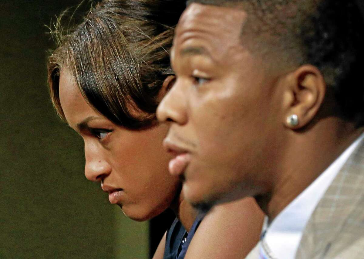 Janay Rice looks on as her husband, Baltimore Ravens running back Ray Rice, speaks during a news conference on Friday at the team's practice facility in Owings Mills, Maryland.