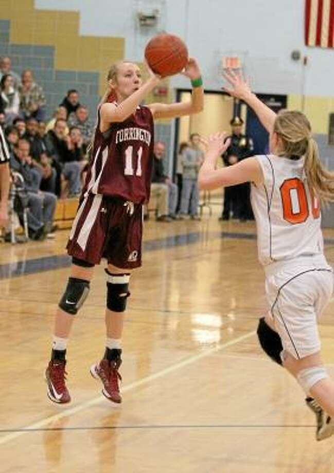 Nicole Kozlak of the Lady Raiders sinks a three pointer in her team's NVL victory over Watertown Thursday night at Kennedy High School. Marianne Killackey/Special to Register Citizen. / 2013