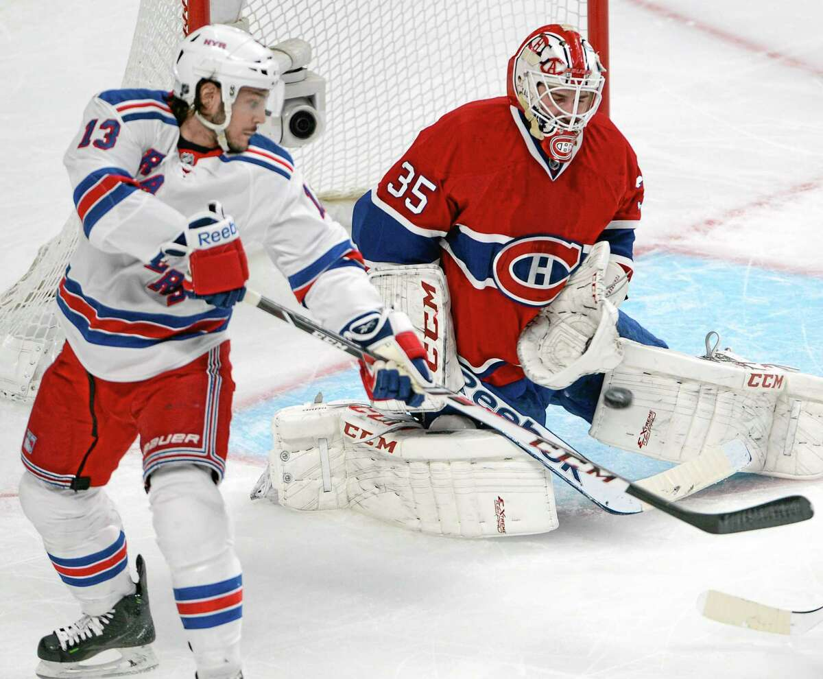 Canadiens goalie Dustin Tokarski stops New York Rangers left wing Daniel Carcillo during the second period of Game 2 of the Eastern Conference finals on Monday in Montreal.