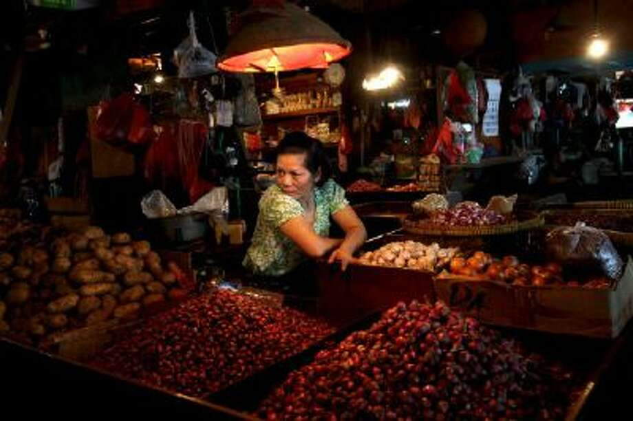 A spice seller waits for customers at a market in Jakarta, Indonesia, Wednesday, March 20, 2013.