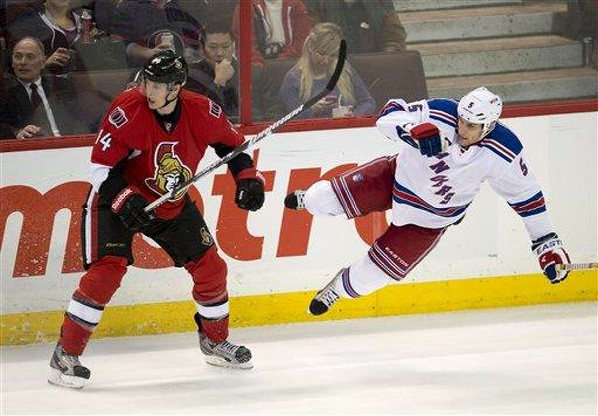 Ottawa Senators center Colin Greening, left, looks away after a collision with New York Rangers defenseman Dan Girardi during the second period of an NHL hockey game in Ottawa, Ontario, Thursday, Feb. 21, 2013. (AP Photo/The Canadian Press, Adrian Wyld)