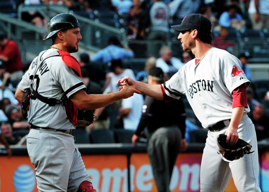 Red Sox pitcher Craig Breslow, right, shakes hands with catcher Ryan Lavarnway after the Red Sox defeated the Yankees in September last season. Photo: The Associated Press File Photo  / AP2013
