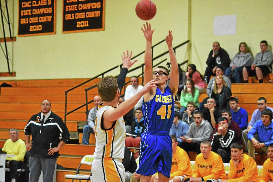 Gilbert's Matt Coon hits a 3-pointer during the Yellowjackets 65-38 win over Thomaston. Coon finished with 10 points. Photo: Pete Paguaga — Register Citizen