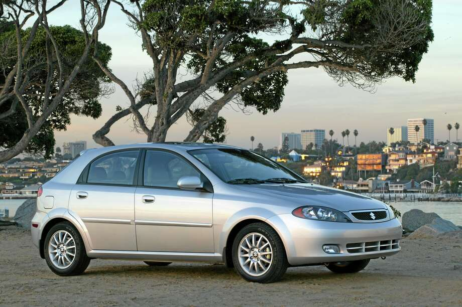 FILE - This undated file photo provided by Suzuki shows the 2005 Reno. Suzuki is recalling more than 184,000 small cars in the U.S. because the steering columns can catch fire. The recall covers Forenza models from 2004 through 2008 and Reno models from 2005 through 2008. Both vehicles were made for Suzuki by General Motors. (AP Photo/Suzuki, File) Photo: AP / Suzuki