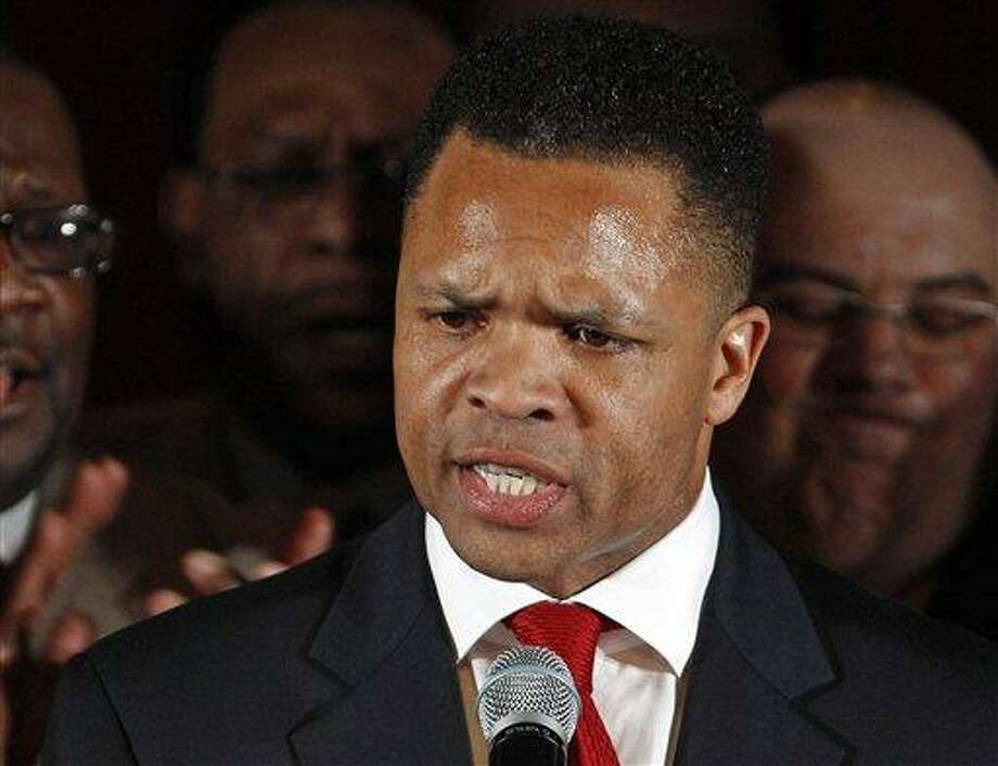 FILE - In this March 20, 2012, file photo taken in Chicago, then-Rep. Jesse Jackson Jr., D-Ill. speaks at a Democratic primary election night party. Jackson and his wife are to appear in federal court to answer criminal charges that they engaged in an alleged scheme to spend $750,000 in campaign funds on personal items.  (AP Photo/M. Spencer Green, File) Photo: AP / AP