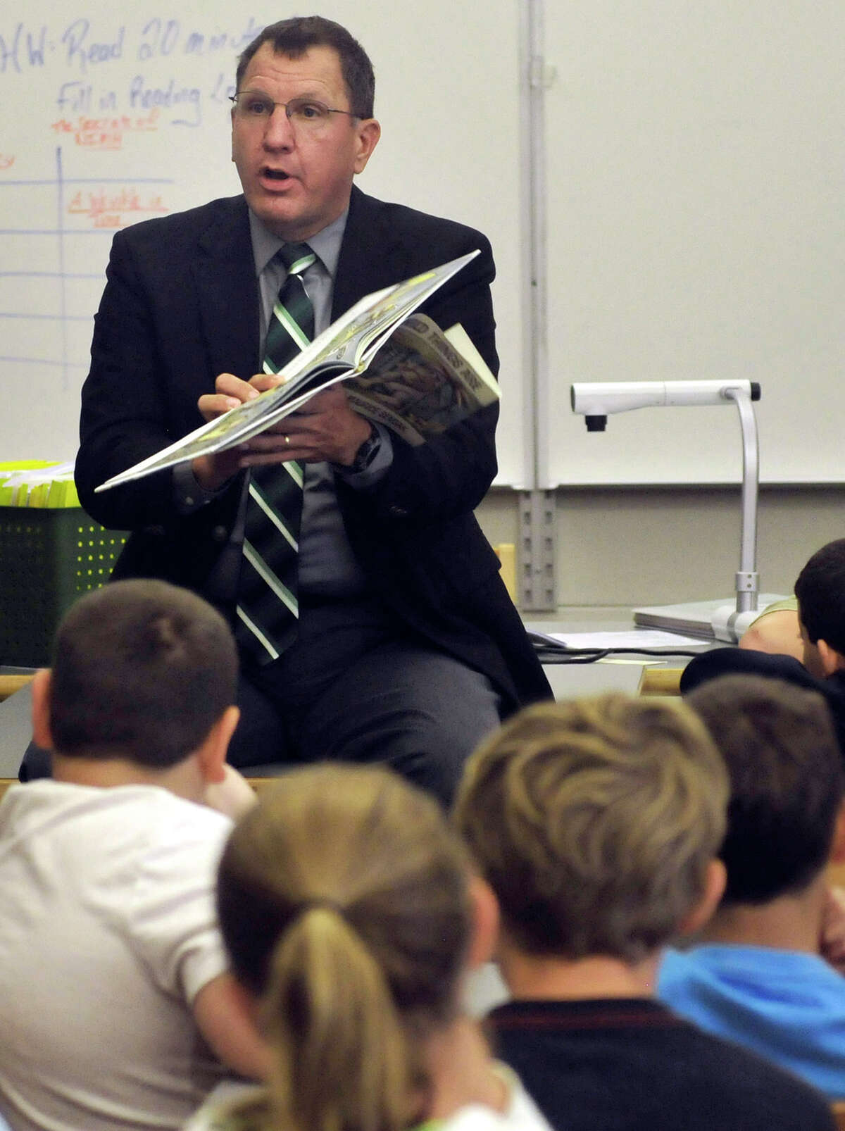 Tuscarora School District Superintendent Dr. Charles Prijatelj reads during International Literacy Day Monday, Sept. 8, 2014 at James Buchanan Middle School, in Mercersburg, Pa. (AP Photo/Public Opinion, Markell DeLoatch)