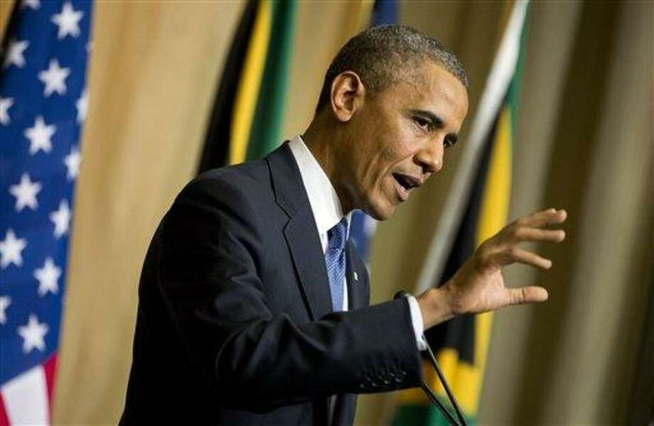 U.S. President Barack Obama gestures during a news conference with South African President Jacob Zuma, not pictured, at the Union Building on Saturday, June 29, 2013, in Pretoria, South Africa. The president is in South Africa, embarking on the second leg of his three-country African journey. The visit comes at a poignant time, with former South African president and anti-apartheid hero Nelson Mandela ailing in a Johannesburg hospital. (AP Photo/Evan Vucci) Photo: AP / AP